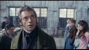 Valjean is unnerved by Javert's first appearance in his office
