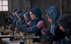 Fantine threading the black rosary beads in the factory, filmed in the Tarring Yarn House, Chatham